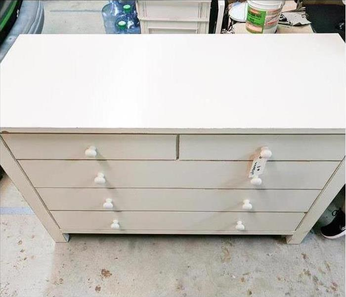 Photo of the same white dresser after cleaning, looking as good as new