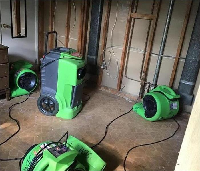 Our large dehumidifier and air mover working to dry this carpet